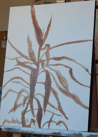 An underpainting whose drawing is filled in a (turpentine) wash in burnt umber. Background still white gesso.
